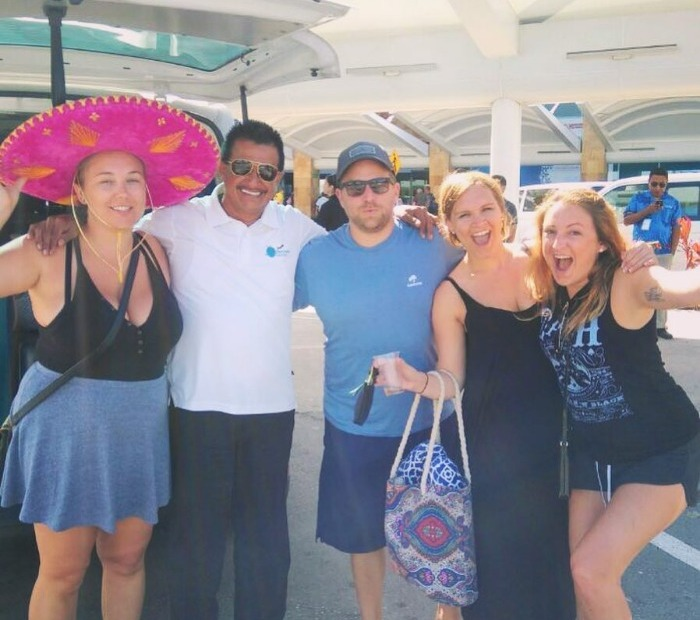 Rafael with happy customers in Cancun Airport.
